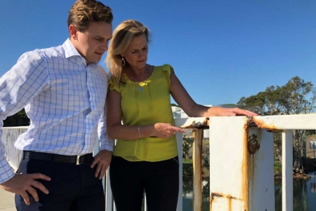 Taylor Martin inspects the bridge with Central Coast councillor Jilly Pilon.