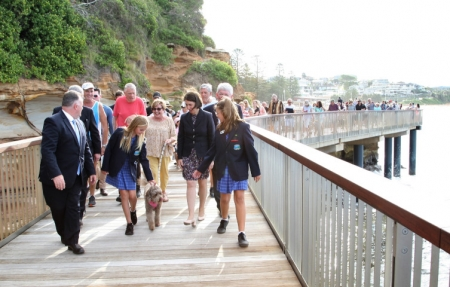 Local MP Adam Crouch and Premier Gladys Berriklian lead locals along the new boardwalk.