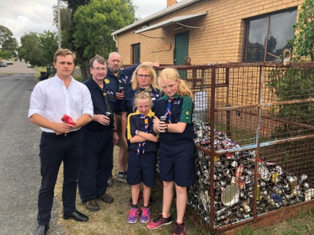 Taylor Martin with disgruntled scouts and leaders of 1st Wyong Scout Group near their can collection cage.