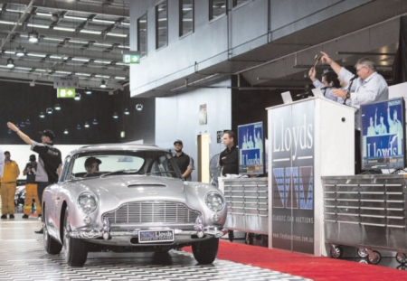 The 1964 Aston Martin DB5 which sold for $1.55M.