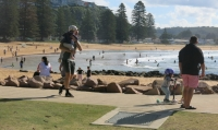 Avoca Beach is popular with families and visitors alike.