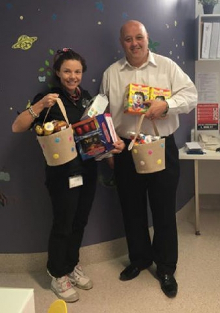 Michael Cordi presents Easter Eggs to Kami at Ronald McDonald family centre.
